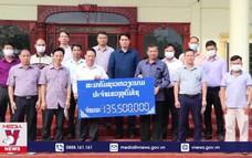 Cộng đồng người Việt tại Lào hỗ trợ khống chế Covid-19