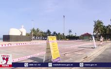 Biển Đà Nẵng vắng vẻ ngày đầu cấm tắm